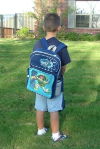 Ready for the bus with his new backpack...